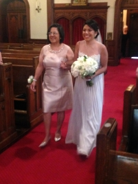 Monica walking down the aisle with her beautiful mom, Lydia